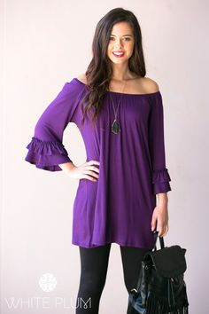 Start the day out right by slipping into the Ruffle Sleeve Tunic Dress from White Plum! The unique elasticized neckline provides lots of styling options and adorable ruffle sleeves are sure to add a little oomph to your everyday ensemble. Whether you're running errands or going out with the girls, slip into this tunic with leggings and a pair of booties for a casual chic look to be adored!Colors Available BlackTurquoiseFuchsiaEggplantSizes Available Small (0-4)Medium (6-8)Large (10-12)XL…
