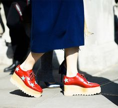 Bold red Stella McCartney platform oxfords with a star and wooden design.