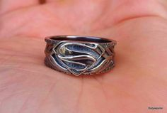 This is our artistic take on what an Armored Superman Ring would look like. Please look at the details that went into making this ring. It is custom made to order item and no two rings are exactly a like making them one of a kind pieces to add to your collection. We offer it in an Oxidized .925 Sterling Silver giving it a unique finish that will sure to be a conversation piece for years to come. Due to the overwhelming response of our customs we are about a 3 week turnaround but that just…
