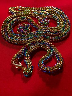 Stunning Chainmail Necklace, earrings and Bracelet in gold and multi- colored rings. On Allen Soaps Facebook page.