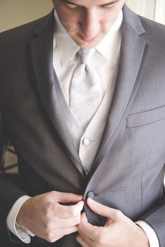 groom in grey tux, photo by rubberbootsphotography.com