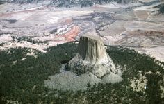 """Devils Tower  which means """"Bear Lodge"""" and """"brown buffalo horn"""", respectively) (Arapaho: Wox Niiinon  is an igneous intrusion or laccolith located in the Black Hills near Hulett and Sundance in Crook County, northeastern Wyoming, above the Belle Fourche River. It rises dramatically 1,267 feet (386 m) above the surrounding terrain and the summit is 5,114 feet (1,559 m) above sea level."""