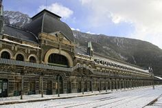 Canfranc, Huesca, Spain. The abandoned nazi railway station in the mountains that fell into disrepair... and now hides a secret laboratory researching dark matter.