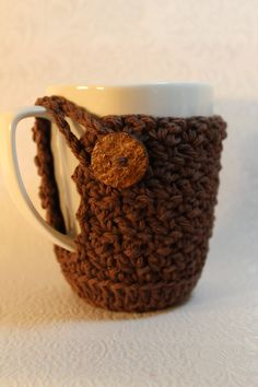 Handmade Crochet  Coffee Tea Cup or Mug Coaster and  Cozy All In One in the Color Warm Brown. $8.00, via Etsy.