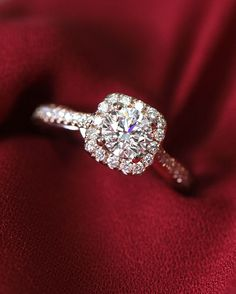 This rose gold engagement ring features a cushion shaped halo unlike any other!
