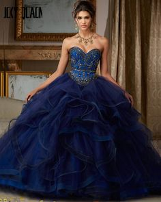 Jeweled Beading on Flounced Tulle Ball Gown Pretty quinceanera dresses, 15 dresses, and vestidos de quinceanera. We have turquoise quinceanera dresses, pink 15 dresses, and custom Quinceanera Dresses! Xv Dresses, Quince Dresses, Ball Gown Dresses, Pageant Dresses, Evening Dresses, Summer Dresses, Navy Blue Quinceanera Dresses, Mori Lee Quinceanera Dresses, Turquoise Prom Dresses