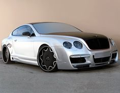Custom Bentley Continental GT in Grey and Black on Forgiato Wheels Bentley Gt, Bentley Rolls Royce, High End Cars, Mens Toys, Bentley Continental Gt, Unique Cars, Amazing Cars, Awesome, Bugatti Veyron