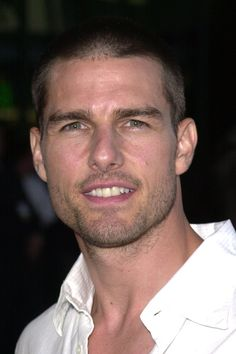 Pin for Later: These Hot Tom Cruise Pictures Will Convince You Age Is Just a Number  Tom Cruise looked sexy with shorter hair for The Others premiere in LA in August 2001.