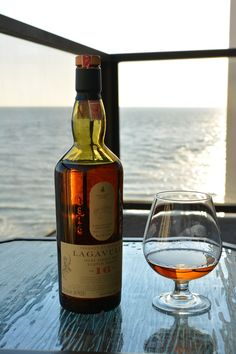 """whiskeytimes:  """"Lagavulin by the sea"""". What a beauty. Have a great Whiskey Weekend from Whiskey Times. whiskeytimes.com Whiskey Times is dedicated to the passion, culture, and elegance of whiskey. Come see our reviews of whiskey, lounge furniture, books, gifts and more. Connect with us. Whiskey Times: Whiskey Times 