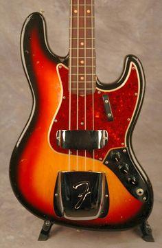 Fender 1964 Jazz Bass with ashtray pickup covers attached. 3 tone sunburst finish