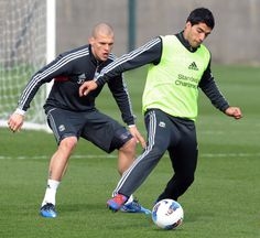 Luis Suarez training with Martin Skrtel