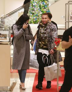 Helping hand: Kylie Jenner was seen shopping in Topanga California on Friday with rumored boyfriend Tyga, who appeared to be carrying all the bags