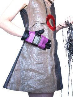 This dress is made from fabric woven from reused cassette tape. The artist, Alyce Santoro calls it Sonic Fabric. You can actually play the dress with these gloves which have tape heads on them.