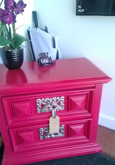 Vintage side table repainted in a couture hot pink, accented by the fabulous original hardware that has been refinished in a brushed nickel finish... SOLD-2014