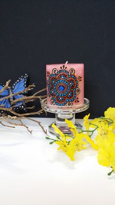 beautiful candle painted with henna and acrylic