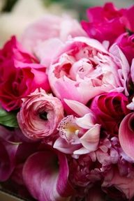 peonies and ranunculus and roses and lilies...i love the colours