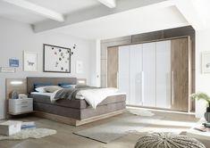 """Moderní ložnicový nábytek s příjemnou barevnou kombinací bílého skla a dekoru """"Karo"""" a luxusní boxspringovou postelí. Furniture, Home Decor, Bedrooms, Products, Oak Tree, Bed, Decoration Home, Room Decor, Bedroom"""