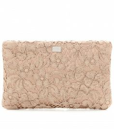 Ladylike styling meets sensuality with Dolce & Gabbana's taupe lace clutch. Clean lines and a compact size make it an all-season investment.