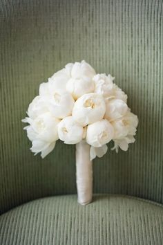 Monochromatic Wedding Details: Few wedding bouquets are quite so chic (and as at home in any theme) as a white peony bouquet. This monochromatic statement is simple and pretty. You can do this with any color to create different moods. For example, a bright coral peony bouquet will be lively and fun, whereas this white bouquet is serene and elegant.