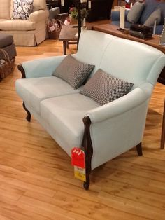 Baby blue glove leather traditional loveseat. An absolutely fabulous price of 2230.99 down from 3499.99.
