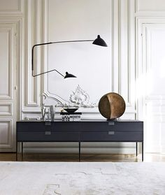 modern and sleek black cabinet and light fixture / sfgirlbybay