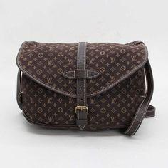 Louis Vuitton Saumur 30  Monogram Mini Lin Cross body bags Brown Canvas M95227