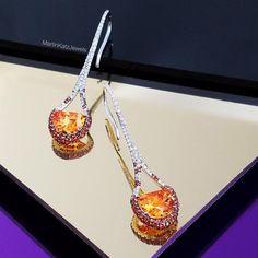 Martin Katz Jewels. Eiffel Tower Drop Earrings featuring Half Moon Spessartite Garnets set with Orange Sapphires and Diamonds.