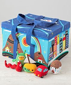 Our City in a Box has tons of surprises inside. Open the box and you'll find it's a foldable city play mat filled with bright scenes and roads. The soft, plush characters are ready for any kind of adventure, too. When you're all done, snap the buttons together and your magical city transforms back into a box! Designed exclusively for us by Michelle Romo.