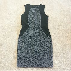 Gray and Black Leopard Print Sheath Dress Gray and black leopard print sheath dress from Ann Taylor. Never been worn. True to size. Hidden back zipper with clasp closure.   No trades.  No paypal. Instagram: @Jhennay262 Ann Taylor Dresses