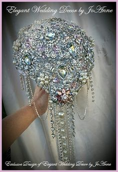 STUNNING FULL BROOCH BOUQUET - $695 (Full Price) - DEPOSIT OF $395.00 To Place your Order - BALANCE - $300 Once 100% completed This is an all Custom Made Full Bridal Crystal Brooch Bouquet. This 9 large Statement Bouquet in All Brooches and Crystals,along with a beautiful unique silver handle design. This Bouquet can be customized to your color scheme. All my Bouquets are handmade in my Southern California Wedding Studio. All Exclusive one of a kind designs, non are copied and reproduced…
