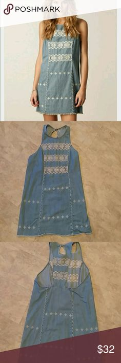 Free people denim mini dress Worn once. Perfect condition. Great with a chunky sweater and leggings for fall. Free People Dresses Mini