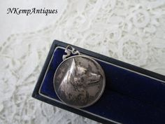Old dog pendant by Nkempantiques on Etsy