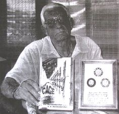 """Don Bordenkircher of Maple Leaf Estates in Port Charlotte holds """"Tiger Cage,"""" a book he wrote about his experiences during the Vietnam War, and some chips from Sadam Hussein's casino and bordello newer Baghdad he acquired during his two years of service in Iraq. Sun photo by Don Moore"""
