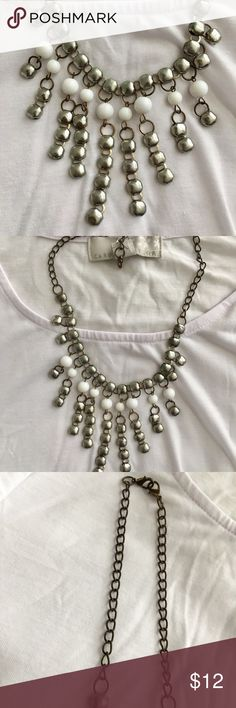 "Necklace ""That Go To, I can't decide"" Chic, Simple yet Bold necklace! 💁🏼 NWOT  The colors make it easy to wear at work, brunch, girls night, the doctors office....   - Hanging White and Dark Metallic Silver  details - Chain Links: Dark Metallic Silver  - Short Necklace fits around bottom of your neck (adjustable) Jewelry Necklaces"