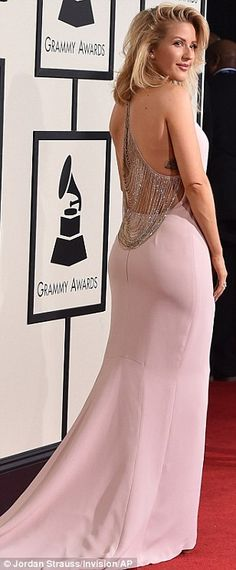 Pretty in pink: Ellie Goulding kept things simple but stylish in a powder pink Stella McCartney gown with unusual fringed back detail