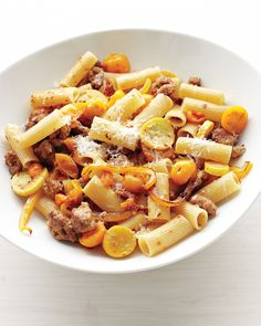 Sweet yellow bell peppers and yellow cherry tomatoes and crookneck squash make for a striking golden summer pasta dish.