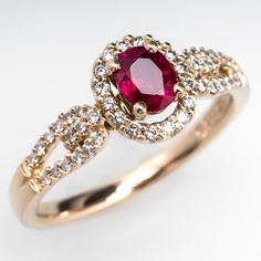 Estate Ruby & Diamond Halo Engagement Ring 14K Gold - This lovely oval cut ruby halo engagement ring is centered with a .51 carat natural ruby. The center stone is accented with a halo of high quality genuine diamonds that continue down the open shoulders. This ring is crafted of solid 14k yellow gold and is in excellent condition.