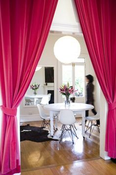 Passionate pink curtains create an intimate and romantic mood in a modern dining room!