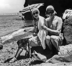 Clowning about: Edward - then King - fools around for a snap with Wallis Simpson during a ...