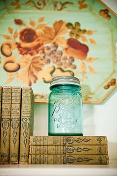blue mason jar on old books