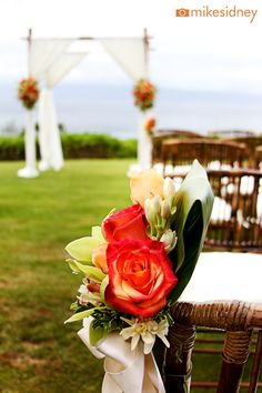 Orange Chair Flowers + Arch    The Wedding Lady - Exquisite Wedding Planning in Maui Hawaii and Vancouver BC    # weddinglady.com