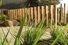 vertical sleeper wall construction - Google Search Fence Design, Garden Design, Sleeper Wall, Garden Dividers, Sleepers In Garden, Fence Landscaping, Pool Fence, Small Front Gardens, Australian Native Garden