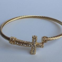 Cable Cross Bangle, $15  StyleLoveLiving / Home