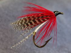 Marsters - Tag, gold tinsel, Tail, grey mallard, Body, white floss, Wing, widgeon or grey mallard flank, Hackle, Scarlet.