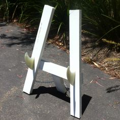 Awesome surfboard stand made by my fiancé using the surfboard fins as holders. He is very clever!!! <3