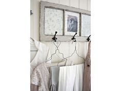 use an old window frame if I could find right size...put old photos in panes