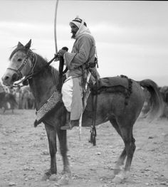 Bedouin life in Trans-Jordan. Sheik Abu Meddin. Known as an intrepid warrior, mounted on an Arab steed, 1920 to 1933,