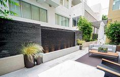 Granite water wall in a semi-private courtyard, Santa Monica, CA