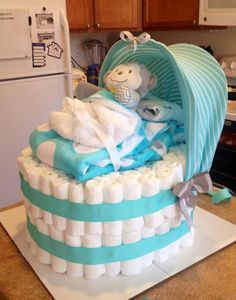 """A bassinet diaper """"cake"""" - a twist on the traditional diaper cake!"""