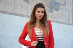 Italian Fashion blogger wearing stripes and red blazer for a spring outfit in Rome